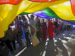 people under giant rainbow flag